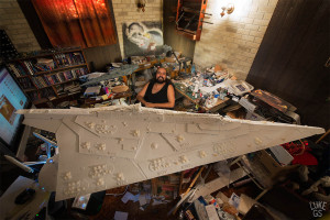 Steve sits with his massive Star Destroyer model, painstakingly built from styrofoam sheets and 3d printed components.