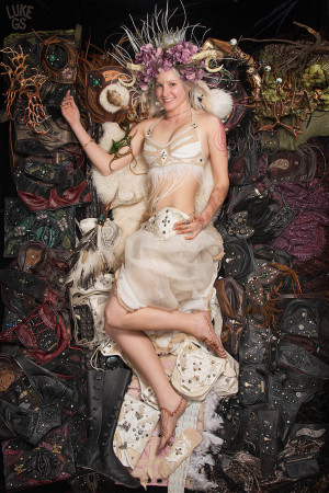 Julia of Krukedgypsy lays atop her leatherwork, looking like a princess out of Labyrinth!