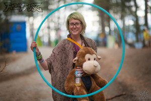 Freya stands with her hoop and monkey at fozzyfest festival