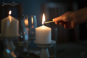 lighting a candle on night before wedding