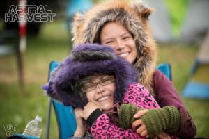 Tara and Jordana snuggle at Astral Harvest Festival