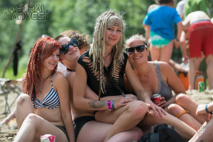 Girls pilled together on the beach at Astral Harvest Festival