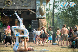 Kate Ryan hula hoops on her foot at Astral Harvest Festival