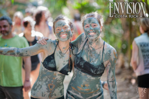 festival goers covered in soothing mud at Envision Festival