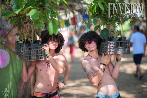 brothers carry trees to plant at envision festival