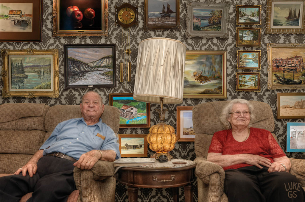 Smith grandparents sit with their paintings